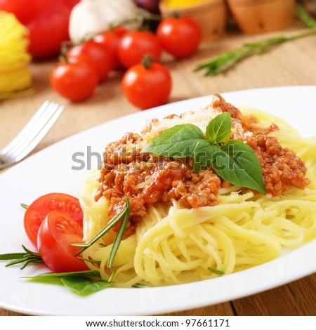 Pasta spaghetti with bolognese beef tomato sauce basil and parmesan - stock photo