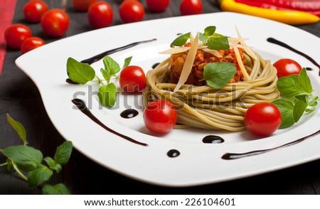 Pasta spaghetti with bolognese sauce, fresh oregano and cheese - stock photo