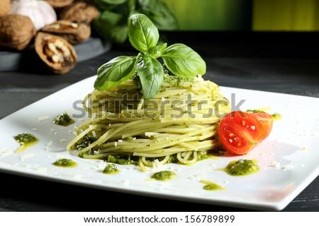 pasta spaghetti with pesto  genovese green background - stock photo