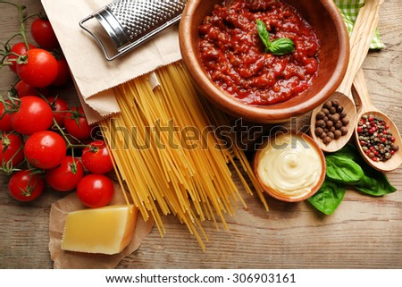 Pasta spaghetti with tomatoes, sauce bolognese, cheese and basil on rustic wooden  background - stock photo