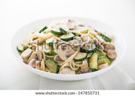 Pasta ( spaghetti ) with zucchini, mushrooms, creamy sauce and parmesan.