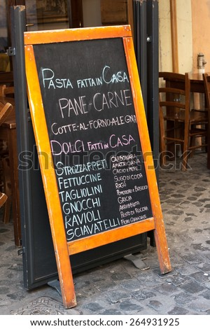 Pasta specialities on a menu board in Rome, Italy - stock photo