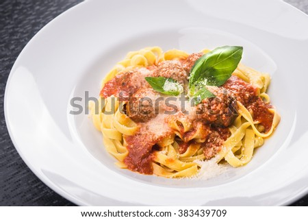 pasta tagliatelle with meat balls on white plate - stock photo