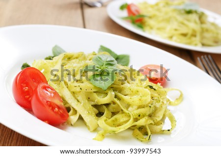 Pasta tagliatelle with pesto sauce basil and grated parmesan - stock photo
