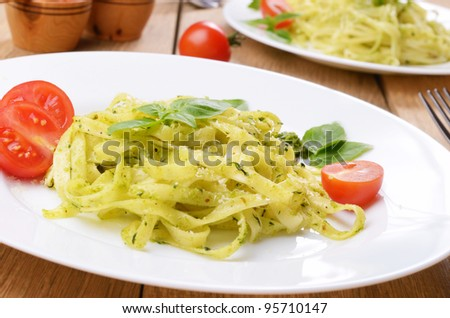 Pasta tagliatelle with pesto sauce basil and grated parmesan