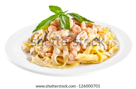 Pasta tagliatelle with seafood isolated on white background - stock photo