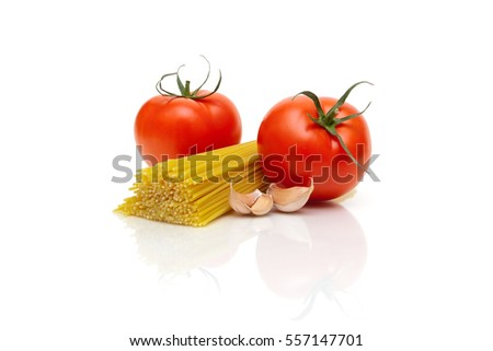 pasta, tomatoes and garlic on a white background. horizontal photo.