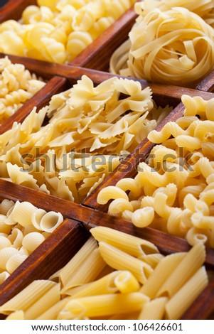Pasta variety in wooden box - closeup - stock photo
