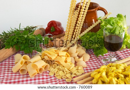 Pasta, vegetables, wine, basic ingredients of Italian and Mediterranean food - stock photo