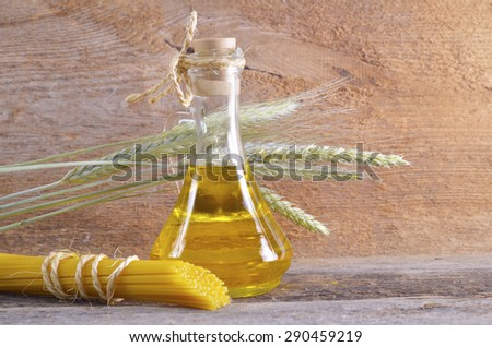 Pasta wheat and vegetable oil battle - stock photo