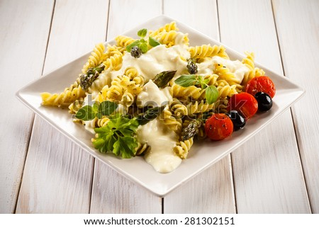 Pasta, white sauce and vegetables - stock photo