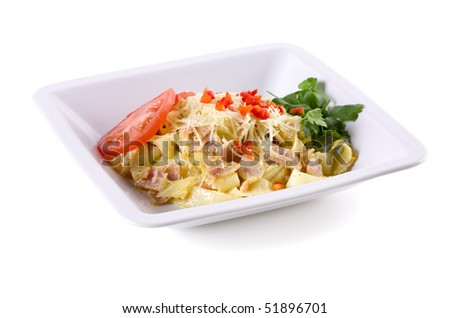 Pasta with a sauce on white plate - stock photo
