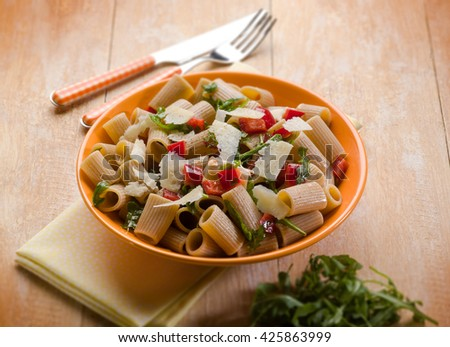 pasta with arugula capsicum and parmesan cheese, selective focus - stock photo