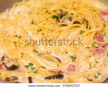 Pasta with bacon and cream sauce - stock photo