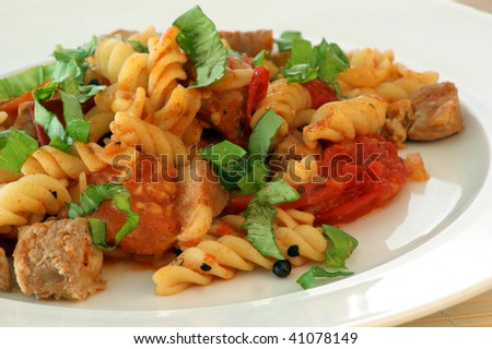 pasta with baked tomato, meat and basil