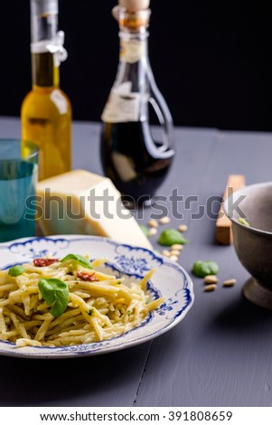 Pasta with basil leaf on the top - stock photo