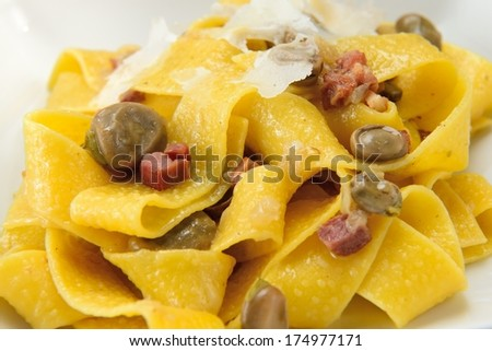 Pasta with bean and bacon - stock photo