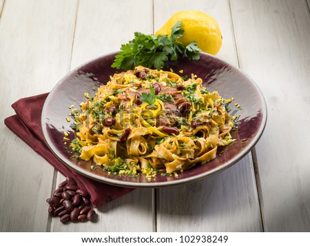 pasta with beans sauce grated lemon peel and parsley, vegetarian food