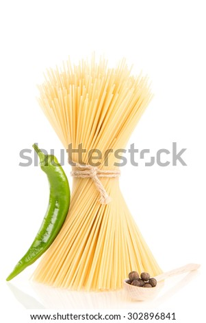 Pasta with black pepper and green hot chilly pepper - stock photo