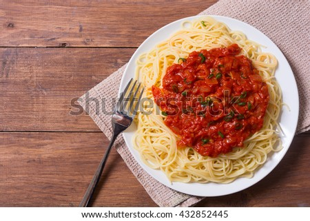 pasta with bolognese sauce on wooden background - stock photo