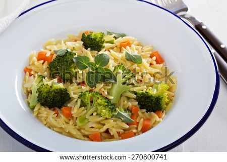 Pasta with broccoli and carrot cooked in stock - stock photo