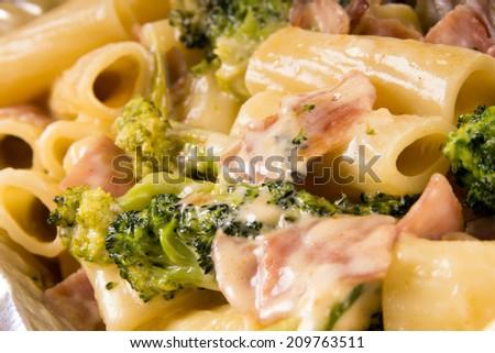 Pasta with broccoli and ham / Pasta - stock photo