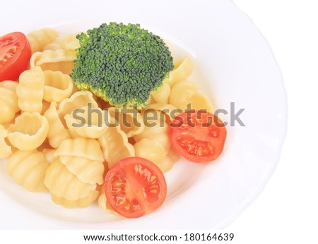 Pasta with broccoli and tomatoes. Isolated on a white background.