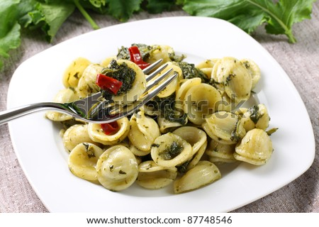 Pasta with broccoli on table - stock photo