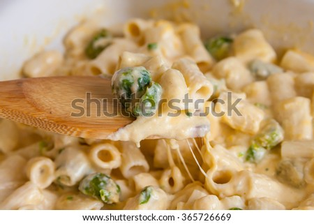 Pasta with cheese, Brussels sprouts and cream sauce - stock photo