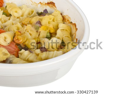 Pasta with cheese gratain in an oval dish isolated on white background.