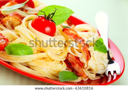 Pasta with cherry tomatoes and bacon - stock photo