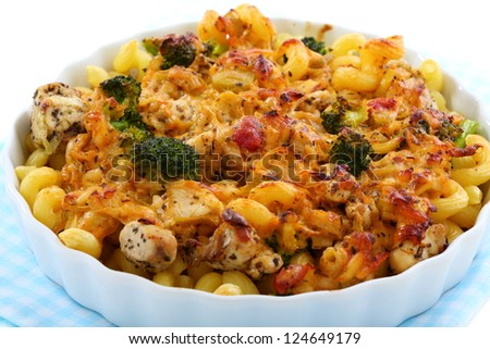 Pasta with chicken and broccoli close-up.