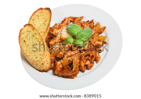 Pasta with chicken and garlic bread - stock photo