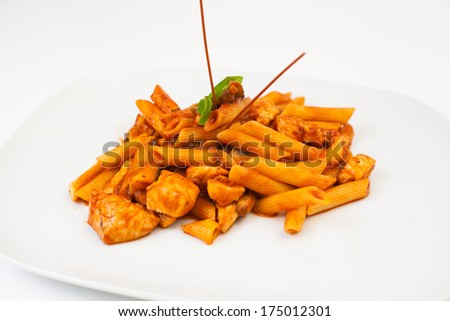 pasta with chicken and sauce on white plate - stock photo