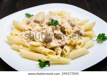 pasta with chicken in cream sauce - stock photo