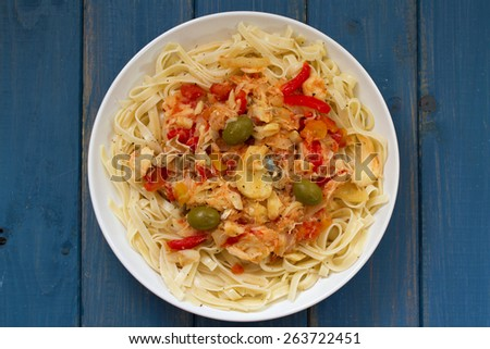 pasta with cod fish and vegetables - stock photo