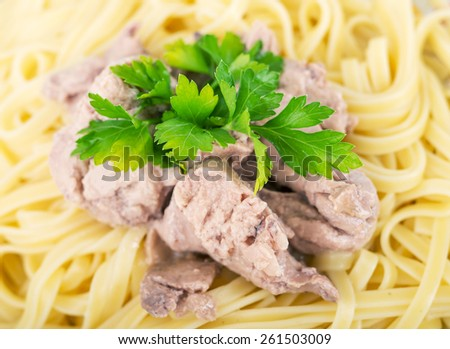 Pasta with cod liver.Selective focus. A little of DOF - stock photo