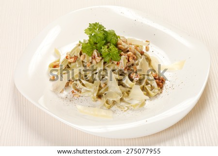 pasta with cream cheese and cedar nuts - stock photo