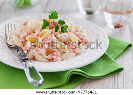 Pasta with cream sauce and crawfish, selective focus