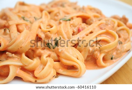 Pasta with Creamy Homemade Tomato Sauce with Basil and Italian Sausage - stock photo