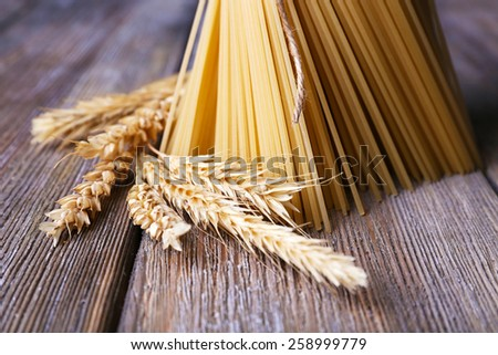 Pasta with ears on wooden background - stock photo