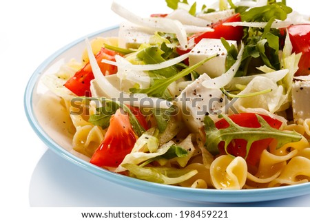 Pasta with feta cheese and vegetables - stock photo