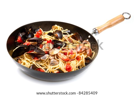 pasta with fresh mollusk and tomatoes sauce - stock photo