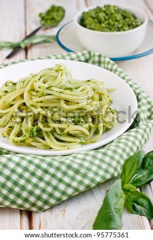 Pasta with fresh pesto sauce - stock photo