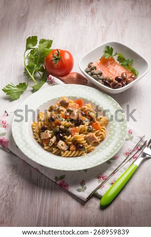 pasta with fresh salmon tomatoes capers and olives - stock photo