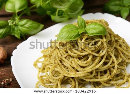 Pasta with green pesto - stock photo