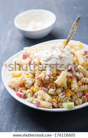 Pasta with ham and vegetables - stock photo