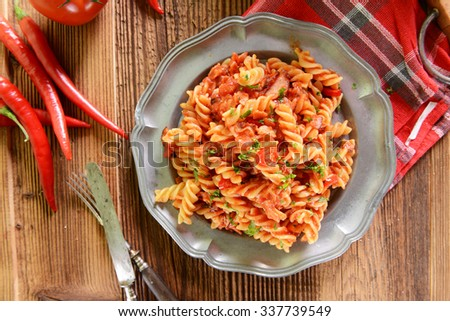 Pasta with hot tomato sauce and chili pepper - stock photo
