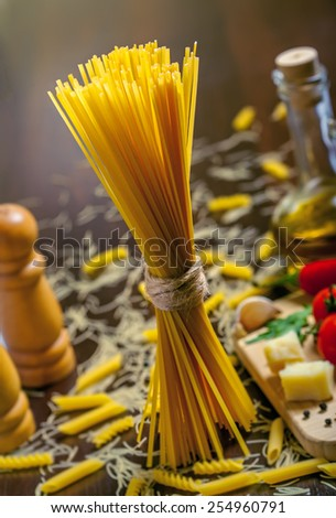 Pasta with ingredients, uncooked food - stock photo