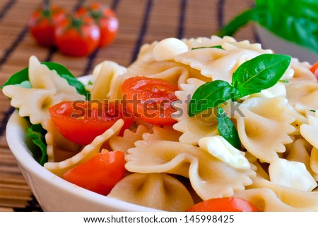 """pasta with italian cheese """"mozzarella"""", basil  and red tomatoes - stock photo"""